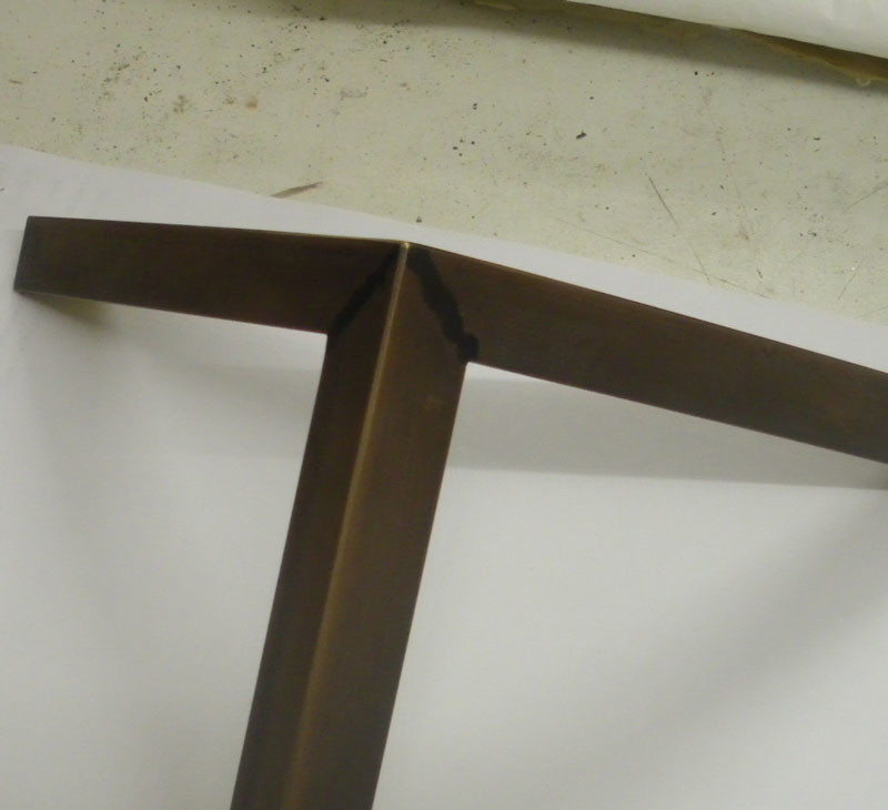 Brass – welded and patinated – crisp edges, fairly strong, but shows the joins