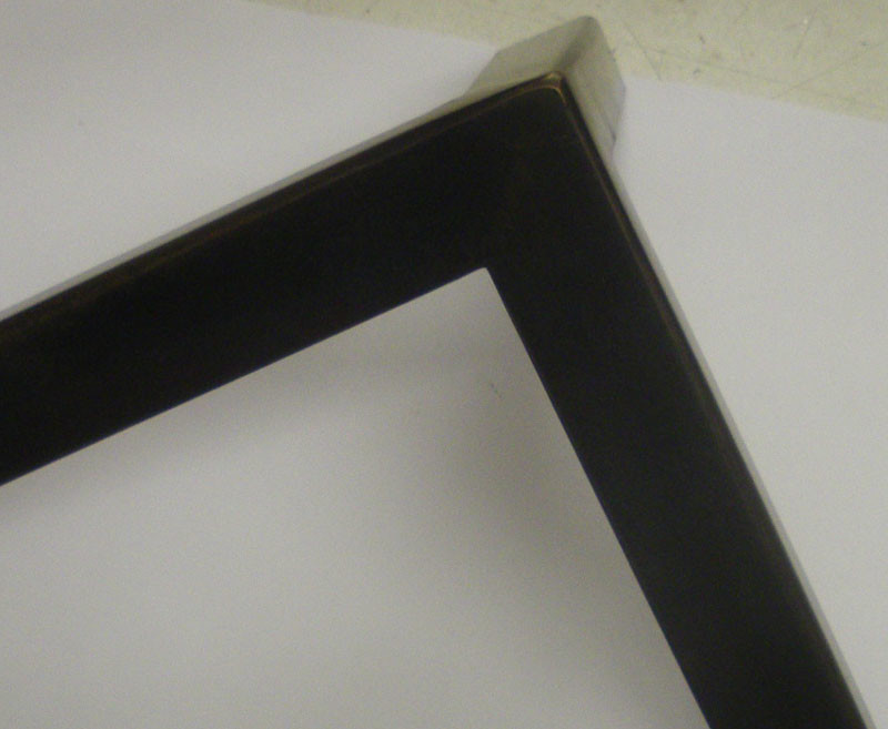 Bronze – welded and patinated, strong and neat – but soft edges.
